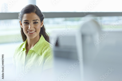 Portrait of smiling brunette businesswoman in office