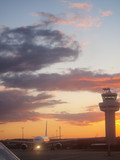 Airplane and air traffic control tower at airport