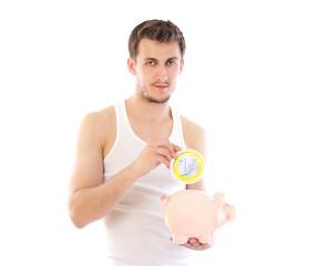 Beautiful man holding piggy bank