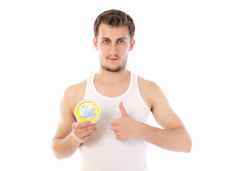 Beautiful man  holding a large euro coin