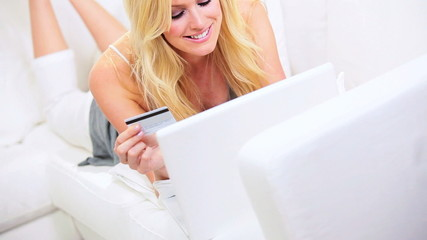 Young Female Using Credit Card Online Shopping