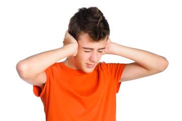 portrait of teenager boy closing his ears and eyes. Teenage trou
