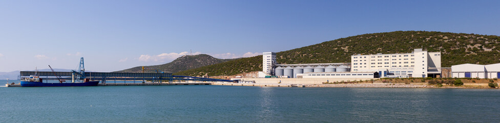 Panorama of a large mill plant with port