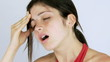 Woman suffering very bad headache