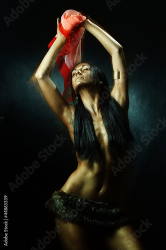 Bronze tanned wild latin woman dancing with red scarf