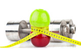 Apples, measuring tape and dumbbells