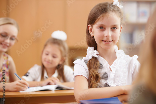Little girl at school class