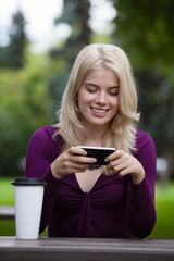 Woman Updating Status on Mobile Phone