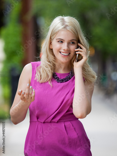 Woman Using Cell Phone in City