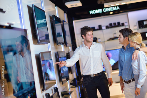 people buy  in consumer electronics store - 44870399