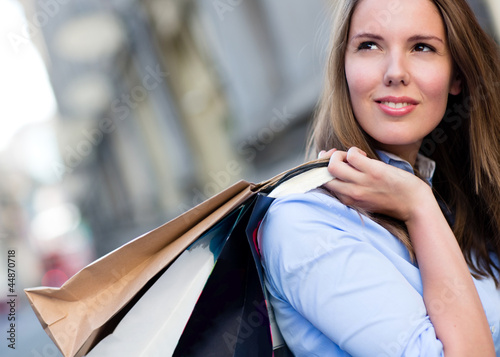 Female shopper daydreaming