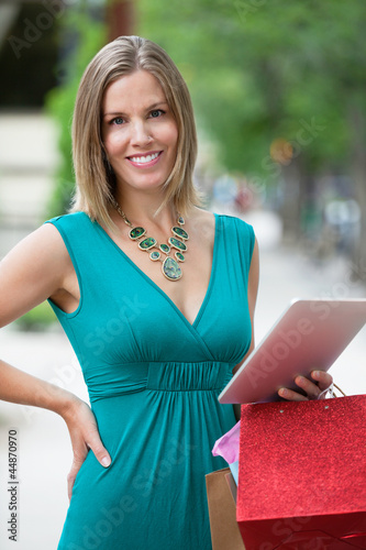 Woman With Shopping Bags And Digital Tablet