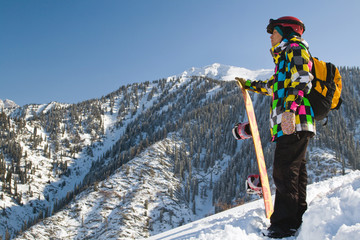 Sport man in snowy mountains