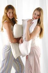 Beautiful couple woman embracing pillow
