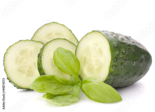Sliced cucumber vegetable and basil leaves still life