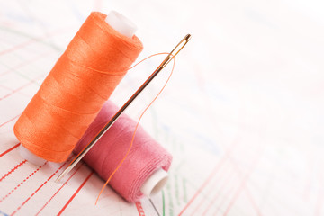 Spool of thread and needle. Sew accessories.