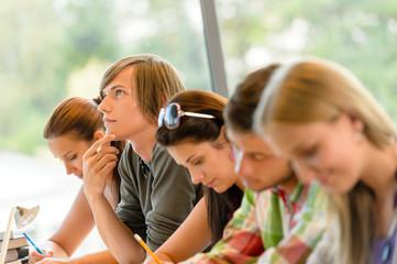 High-school student thinking at exam class teens