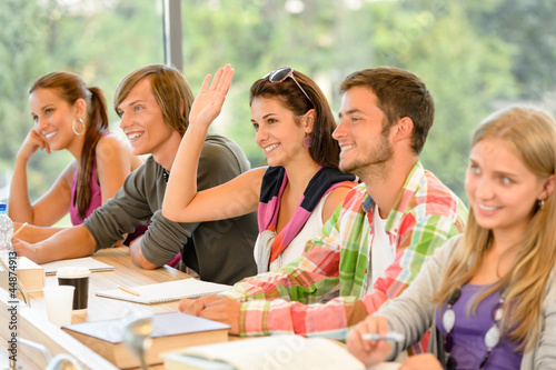 High-school student raising her hand in class