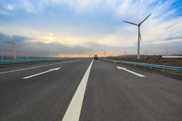 highway with wind turbines
