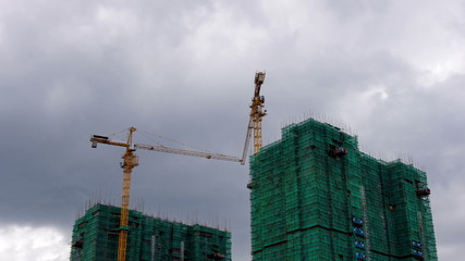 Time lapse of Construction tower cranes,self lifting