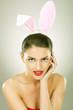 smiling beautiful woman wearing bunny ears