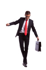 Business man balancing and walking forward