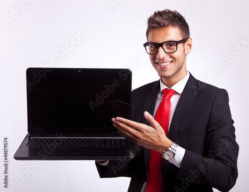 man presenting you with a new laptop