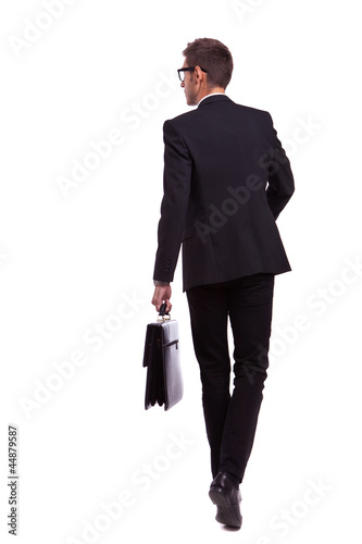 walking business man holding a briefcase