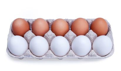 ten white and brown chicken eggs in a carton box
