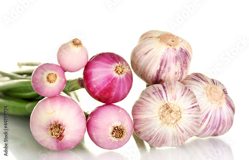 young onions and garlic on white background close-up