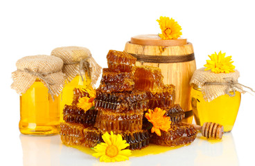 sweet honeycombs, barrel and jars with honey, isolated on white