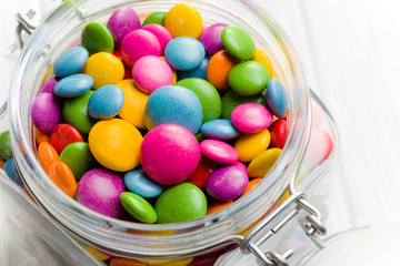 colored candy in glass jar