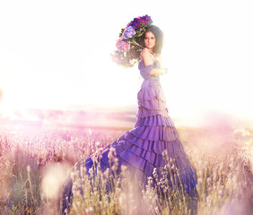 beautiful girl in a lavender field under the umbrella of color