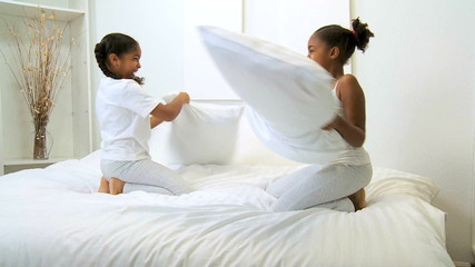 Ethnic Girls Play Pillow Fight
