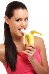 portrait of a banana eating young woman in studio