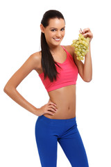 beautiful young woman with grapes on white background