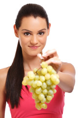 closeup portrait of a woman offering grapes