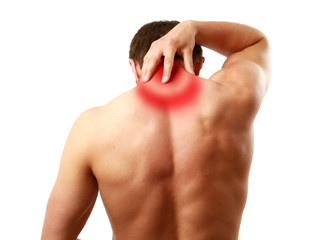 Muscular man with back neck ache isolated on white background