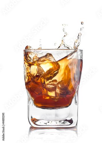 whiskey splash with ice cubes