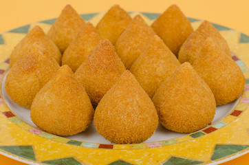 Coxinha: Brazilian deep fried snack filled with shredded chicken