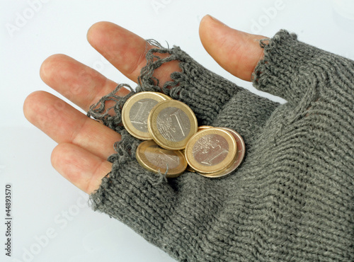 poor man collects alms from a few Euros in his glove