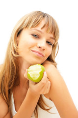 Happy healthy girl with green apple