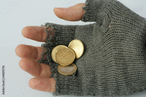 hand into the glove of a poor beggar