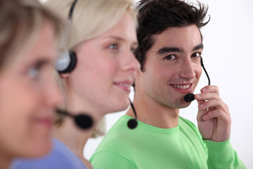 Three young call-center workers