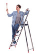 young female painter on ladder with raised brush