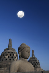 Statue and stupa at borobudur 1