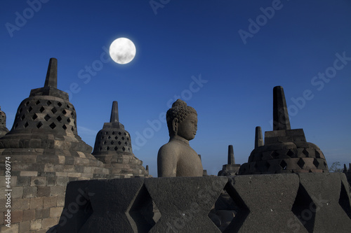 Statue and stupa at borobudur