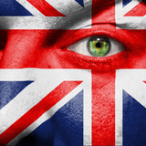 Flag painted on face with green eye to show UK support