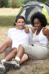 Couple sitting by tent
