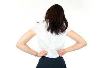 腰痛に悩む女性の後ろ姿+OL